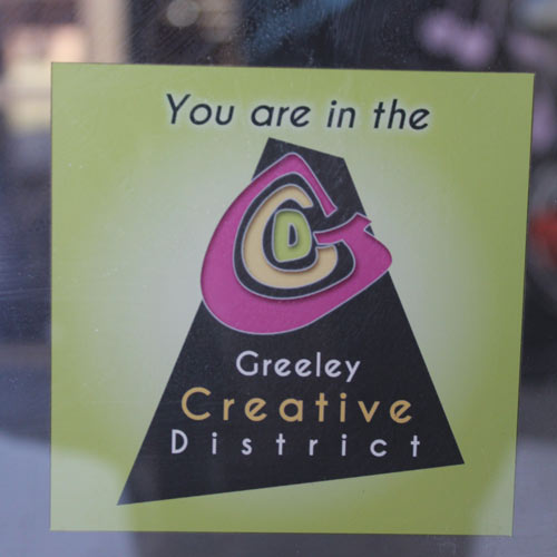 """You are in the Greeley Creative District"" window cling"